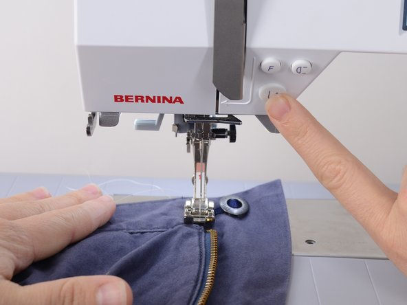 Image 3/3: Remove the garment from the sewing machine.
