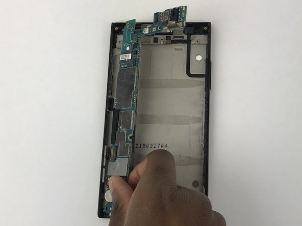 Remove the motherboard from the phone.
