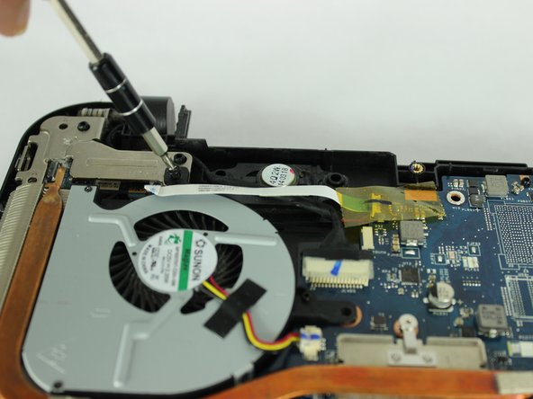 Use a pair of tweezers to unplug the fan from the motherboard.
