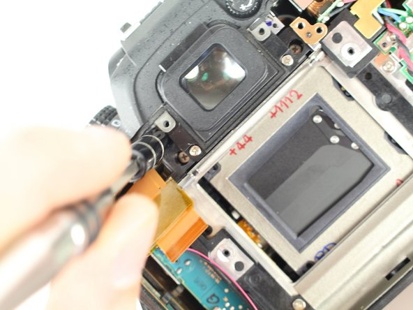 Manually pop up flash by inserting a screw driver to the left of the viewfinder and pressing on the metal lever.