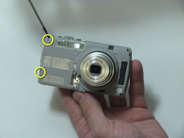 Remove the 2 screws on the left side of the camera.