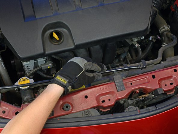 Image 1/3: If not, use one hand to hold the hood open temporarily while securing the hood with the prop rod: