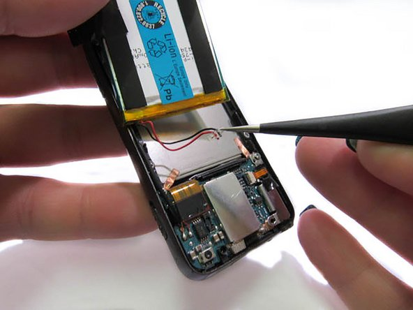 Using pointed precision tweezers, unplug the wires connecting the battery and chip from the chip.