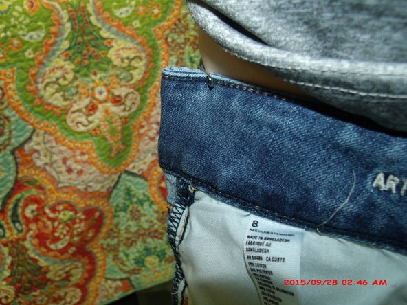 Safety pin the waistband of the pants to the desired fit.