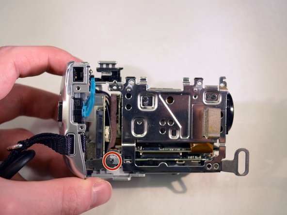 Image 1/1: Remove the bottom left 3mm Philips screw./'''Make a close up of the  screw for this picture.'''