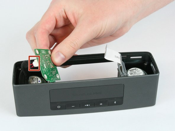 Image 1/3: There is a non latched connector connecting the top board to side board. Be careful to not damage this connector during the removal process.