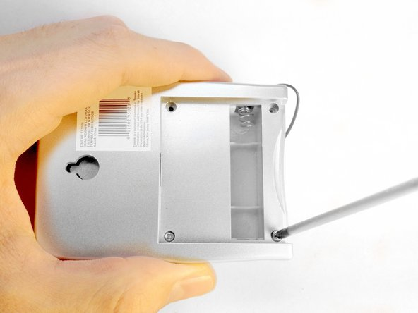 Loosen and remove the four screws from the back of the thermometer.