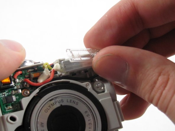 Remove the plastic cover on the flash, by simply grabbing the plastic with two fingers and pulling.
