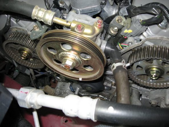 Top view showing timing belt, tensioner, and pulleys off