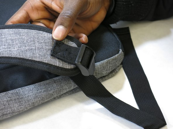 """Sew along the """"X"""" outline on material attached to the buckle."""
