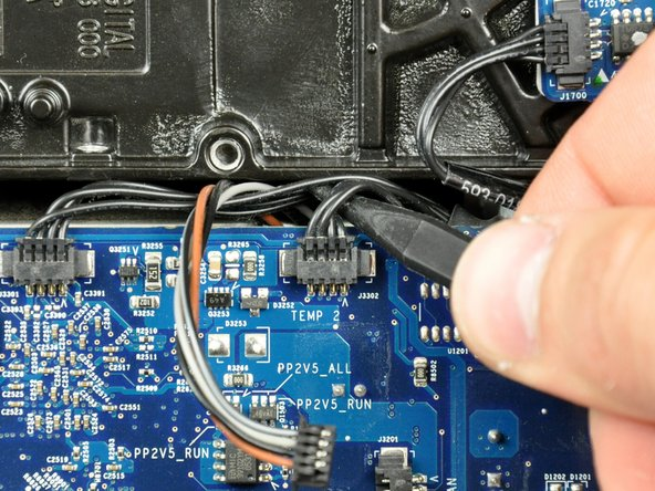 Image 1/2: Disconnect the optical drive temperature sensor connector from the logic board by pulling it straight away from its socket.