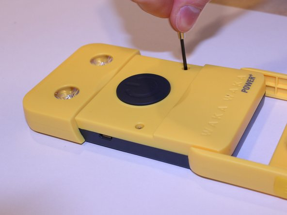 Remove the two 5mm screws with a #0 Phillips screwdriver.