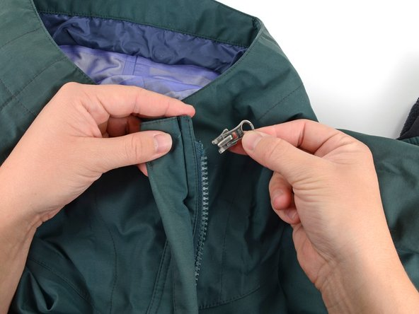 Insert the new slider onto the zipper.