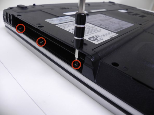 Image 2/2: There are 3-additional screws that need to be removed through the 3-holes located in the optical drive.