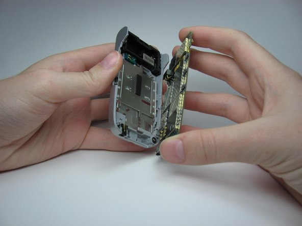 Remove the logic board from the back cover of the phone.