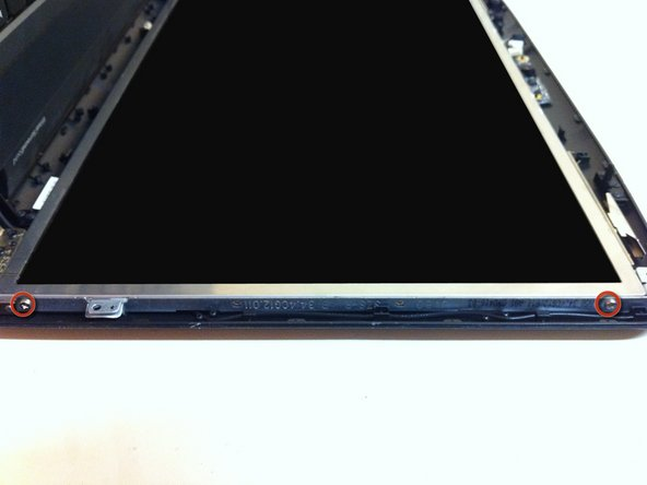 Remove the 4 screws located in the sides of the LCD screen.