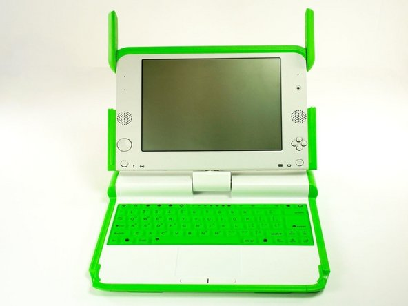 Open the laptop by rotating the green wings on the side up, then lifting the top half of the laptop.