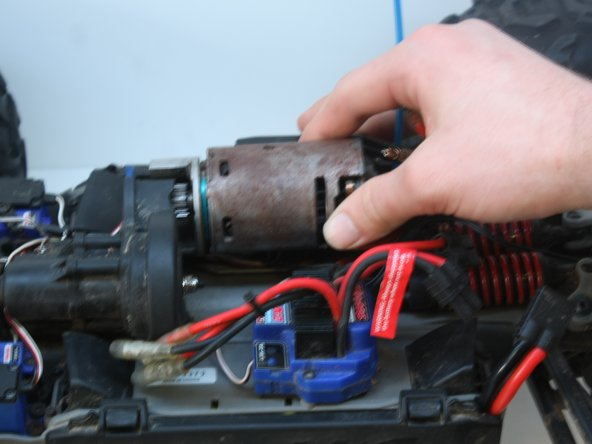 Remove the motor by wiggling back and forth while pulling it to the right and up.