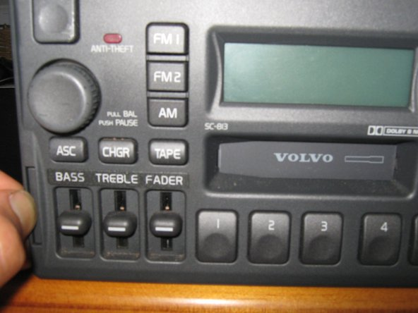 Image 3/3: Most of the SC-XXX model radios have a quick release tap that allows you to remove them with a pop out pull tab.  An anti-theft CODE card will not be necessary because you will NOT be disconnecting the radio power connectors.