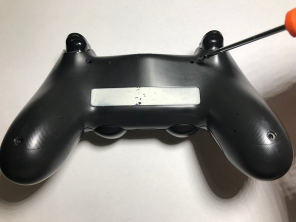 Begin by removing the screws  in the back of the controller.