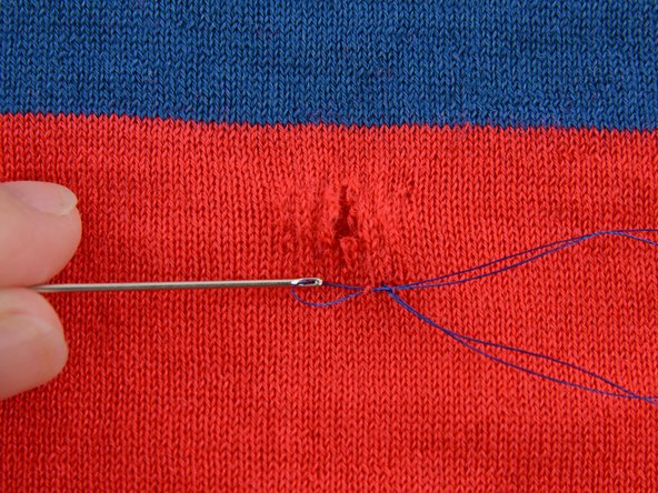 Pull the needle through until the thread is taut, but not scrunching or gathering the fabric.