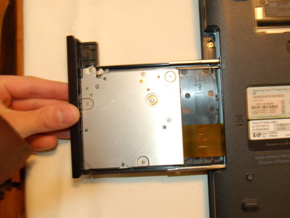 Remove the 3 screws exposed by removing the drive