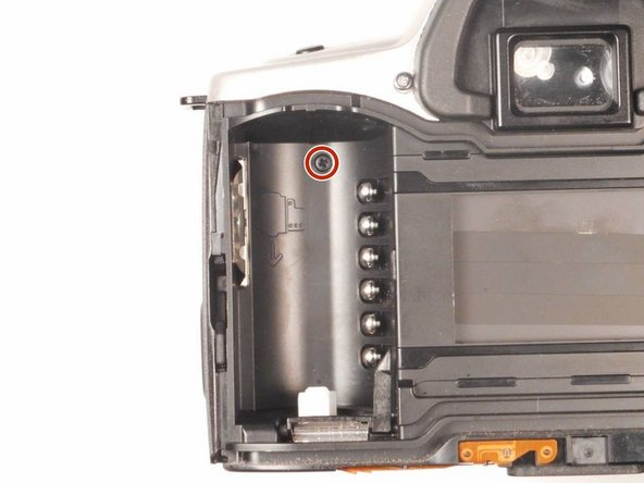 Once the back panel is open, the chamber containing one screw should be visible.