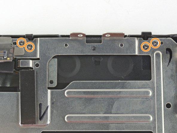 Five black 4.2 mm Phillips screws .
