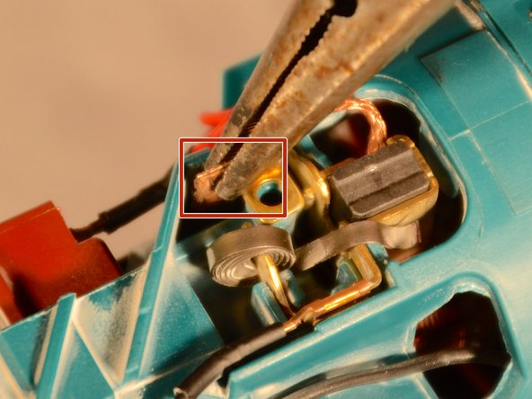 Use needle nose pliers to gently pull out the carbon brushes by their crimped connectors.