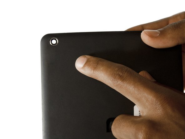 The rear-facing camera is on the left side of the tablet and it aligns with the camera hole on the back casing of your tablet.
