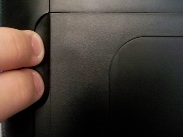 Insert 2 finger in the dent on the right side of the printer and pull towards the front of the printer.