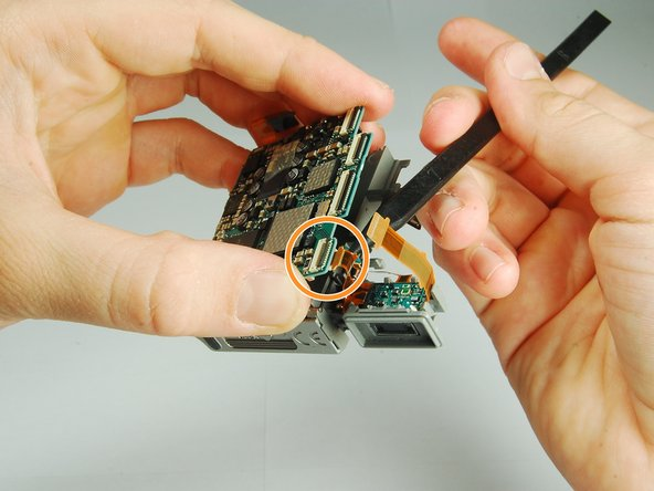 Be careful while separating the board so that you do not damage the ribbon cables or other components.