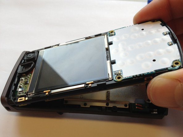 Separate the front panel of the phone by pulling the bottom of the panel at a 45 degree angle.