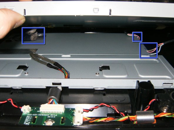 Image 2/3: Remove the LVDS cable. It is a simple push connector, just pull the cable upward.