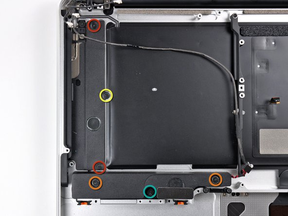 Remove the following six screws securing the subwoofer and right speaker to the upper case: