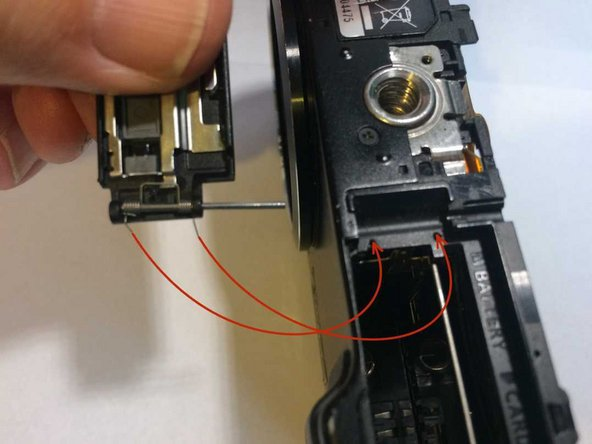 To reassemble, locate the spring ends as shown then close the door before attempting to push the hinge pin back.