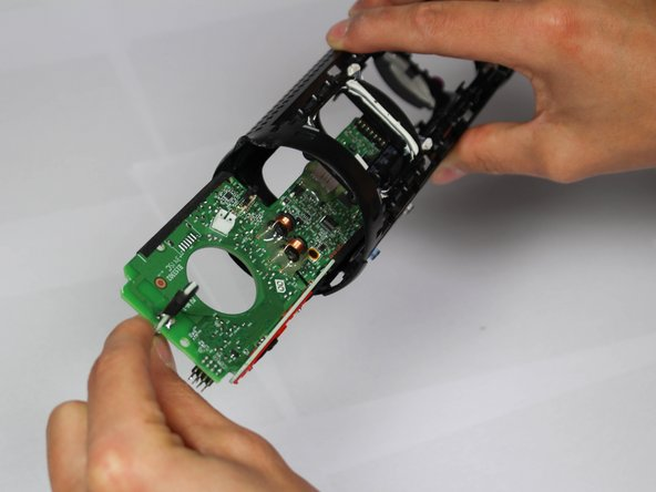 Grab the single piece of green motherboard that runs perpendicular to the motherboard, and pull out of casing.