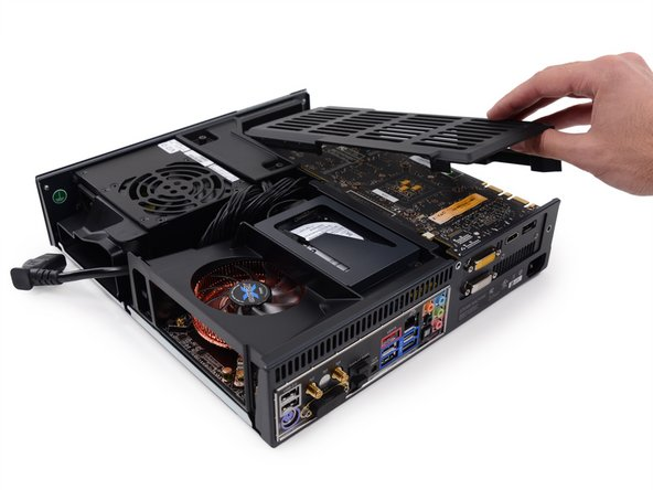 Image 2/2: A molded plastic cowling covers the video card and fills the void between the card and the upper case, protecting it from shaking around and damaging itself.