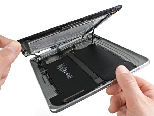Image 1/1: Do not excessively lift the display assembly off the rest of the iPad, as a fragile antenna cable with very little slack still connects the two components.