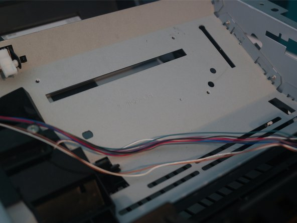 Remove 4 screws from the laser assembly.
