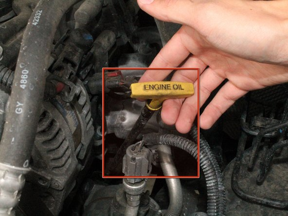 Check the oil level.  First, locate the oil dip-stick (marked in the first image by red).