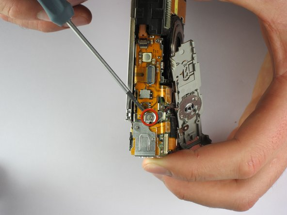 Remove screw attaching the Mini USB Cover to the top of the camera body.