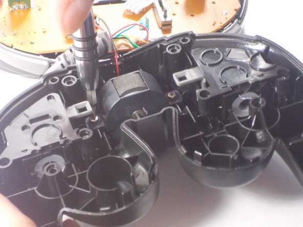 Lift and remove the rumble motor from the case.