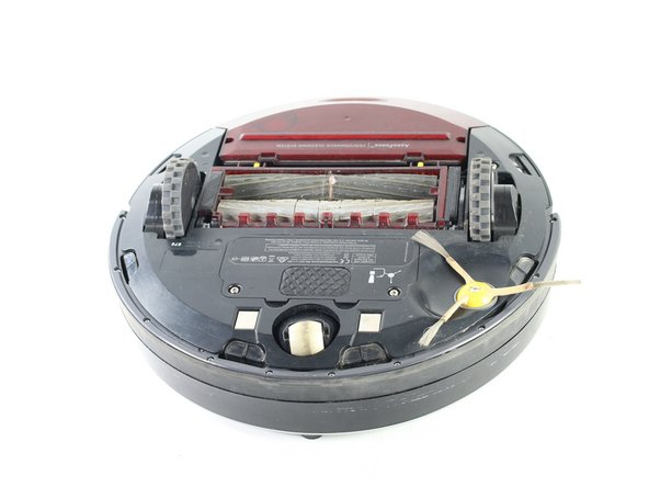 Flip the Roomba on its back so that the wheels are facing up.