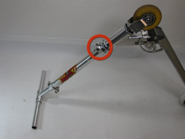 Locate the collar clamp near the base of the steering column.