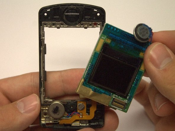 The circuit board containing the outside and inside LCD screen should now easily remove from the phone's casing using your fingers.