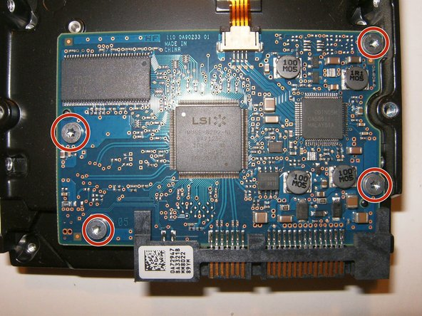 Image 3/3: Remove the four T8 screws from the PCB