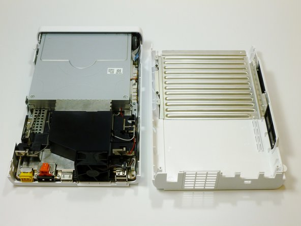 On the back of the console, lift up and release the main top cover.