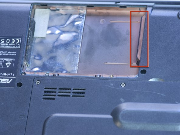 Pull out hard drive laterally from slot shown.