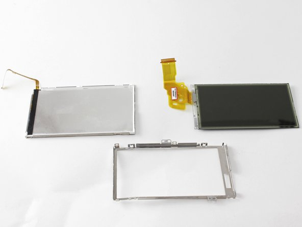 The LCD screen is now removed and can be replaced or set aside to access other camera components.